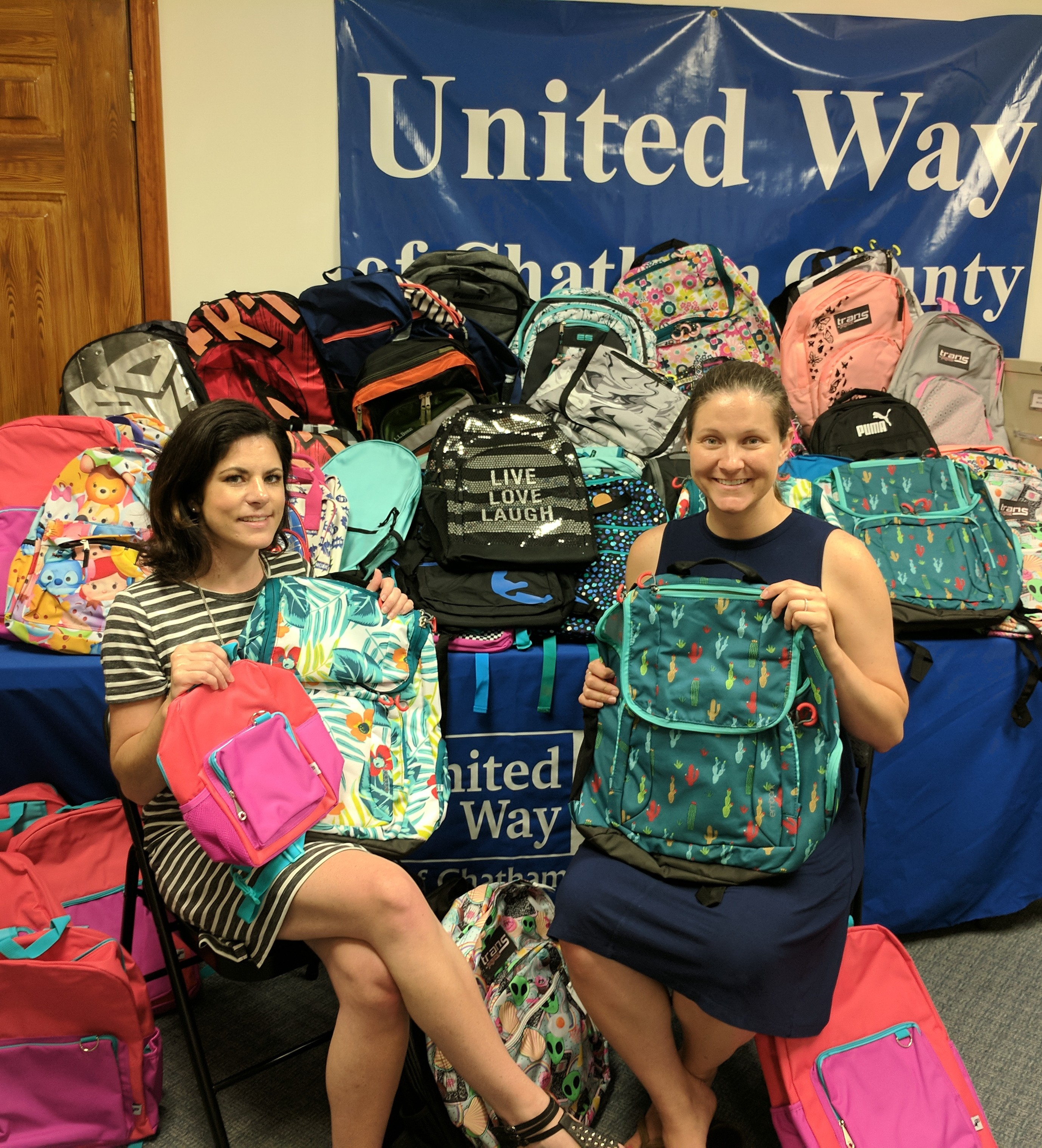 United Way staff members prepare donated supplies for schools.